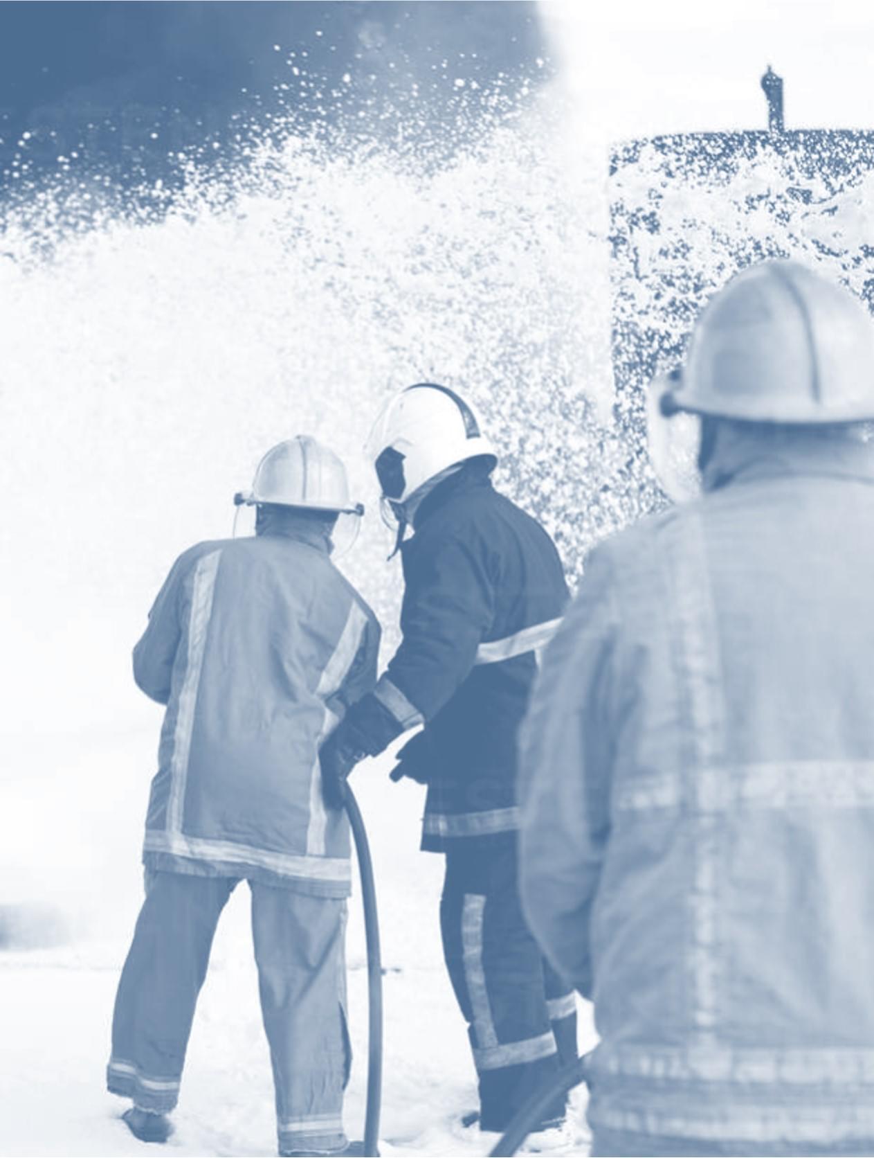 firemen training team spraying firefighting foam