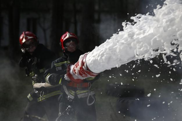 extinguishing-fire-firemen-are-working-fill-foam-with-fire-resolute-firefighters-fight-fire_186673-1